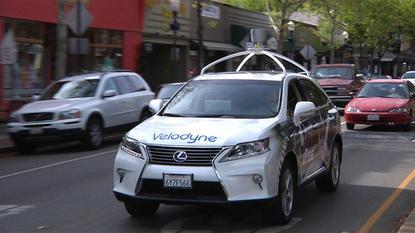 A LIDAR test vehicle of sensor maker Velodyne drives through a California street.