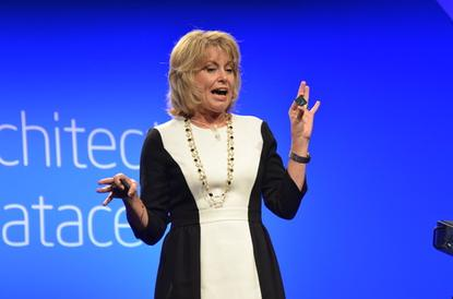 Diane Bryant, head of Intel's Datacenter and Connected Systems Group, holds its new Avoton server chip