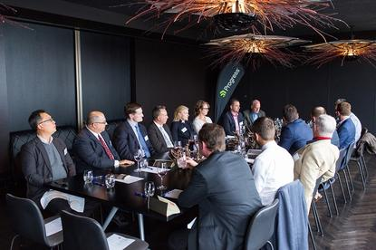Senior IT execs Melbourne discussing how business rules automation is reshaping their application development lifecycle.