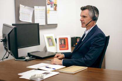 While this photo shows an office worker using a headset, the new version of Nuance's Dragon NaturallySpeaking supports built-in microphones on notebooks.