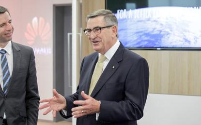 Huawei's John Lord (right)