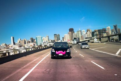 A Lyft car on the road in San Francisco