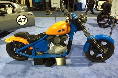 The 3D printed motorcycle created by TE Connectivity to prove to its engineers that polymers can withstand great amounts of stress. The bike is styled after a Harley Davison softwail and can do a whopping 15mph with two riders.