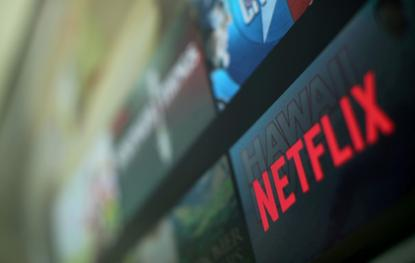 The Netflix logo is pictured on a television in this illustration photograph taken in Encinitas, California, U.S., January 18, 2017. REUTERS/Mike Blake/File Photo