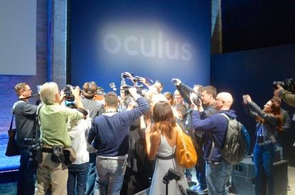 Attendees at the Oculus press event on June 11, 2015, huddle around Oculus VR founder Palmer Luckey to get a look at the Rift headset.