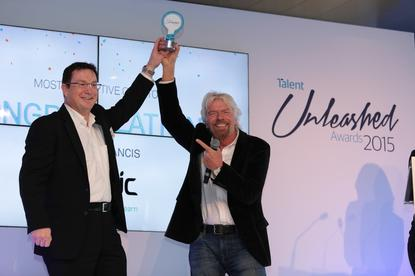 Sir Richard Branson presents Velpic's Russell Francis the 2015 award for 'Most Disruptive CIO'