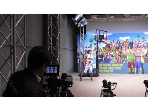 A cameraman shoots video using an experimental camera system from Japanese broadcaster NHK, which links multiple cameras to provide multiple angles of the same scene.