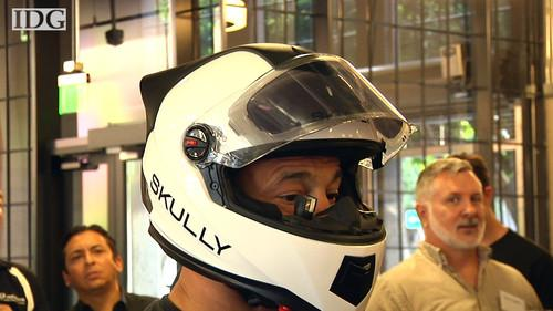 Motorcycle rider trying on Skully AR-1 helmet