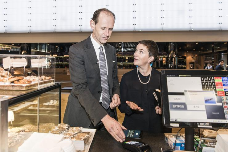 ANZ CEO Shayne Elliott and ANZ GM deposits & payments Katherine Bray using Android Pay.