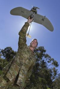 Australian Army soldier Corporal Doug Coombs prepares to launch a Wasp AE small unmanned aircraft vehicle at Gallipoli Barracks in Brisbane
