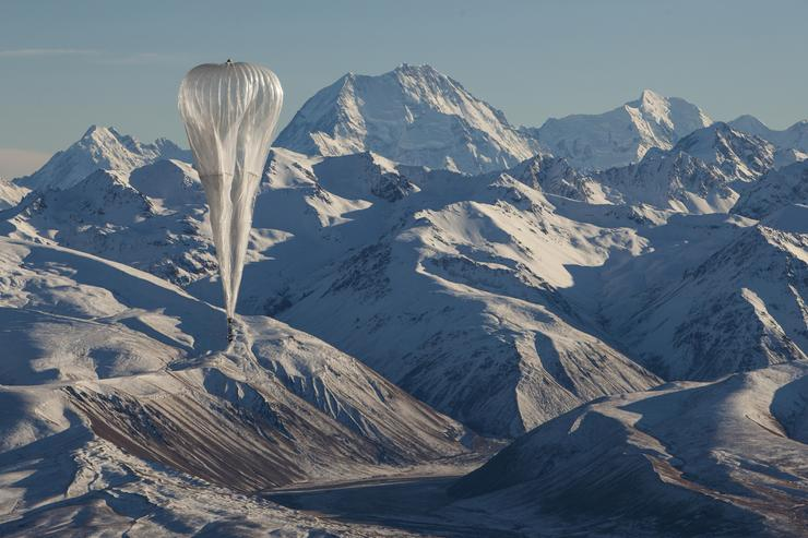 A Loon internet balloon, carrying solar-powered mobile networking equipment flies over rugged terrain in New Zealand, in this photo provided June 27, 2019. Courtesy Loon/Handout via REUTERS.