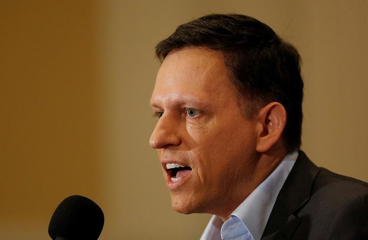 PayPal co-founder and Facebook board member Peter Thiel delivers his speech on the U.S. presidential election at the National Press Club in Washington, U.S., October 31, 2016. REUTERS/Gary Cameron