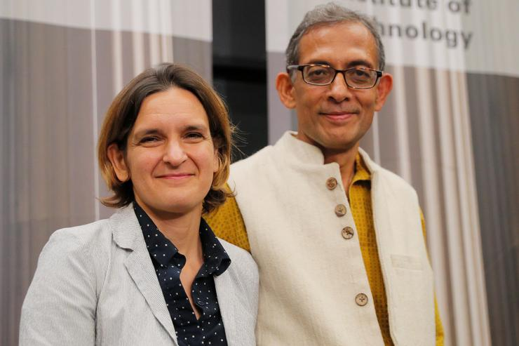 Abhijit Banerjee and Esther Duflo, two of the three winners of the 2019 Nobel Prize in Economics, at a news conference at the Massachusetts Institute of Technology (MIT) in Cambridge, Massachusetts REUTERS/Brian Snyder
