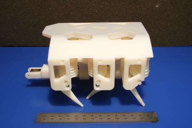 Every part of this 3D hexapod robot was printed in a single step, except its motor and battery. Credit: Robert MacCurdy/MIT CSAIL