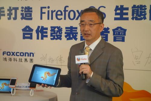 Mozilla executive Li Gong shows off a reference model tablet running the Firefox OS