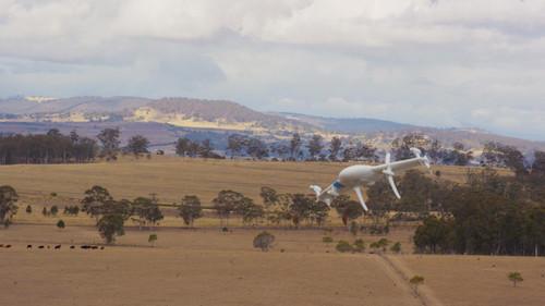 A Google drone flies through the sky.