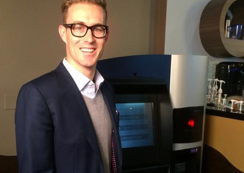 Jordan Kelley, CEO of Bitcoin ATM maker Robocoin, introduces the world's first Bitcoin ATM in Vancouver, Canada, in 2013. The manufacturer is adding bank-style functions to its kiosks in a bid to broaden the appeal of the cryptocurrency.