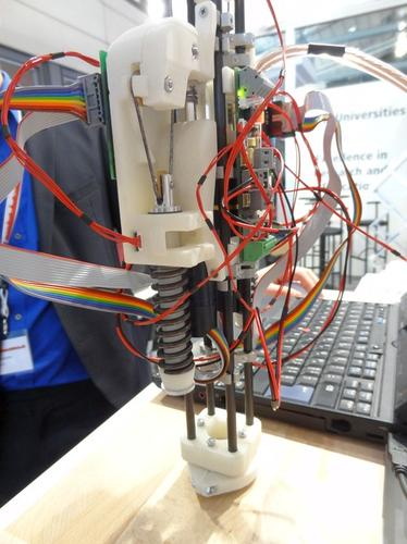 Roboy's muscles and joints build on technology developed by the Myorobotics research project to develop building blocks for safer, cheaper robots. Here, the spring and wire ligament are clearly visible.
