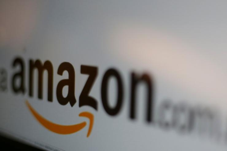 The logo of the web service Amazon is pictured in this June 8, 2017 illustration photo. REUTERS/Carlos Jasso/Illustration/File Photo