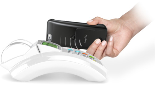 The card creates a magnetic field, so virtually any credit card terminal can read it, no NFC required.