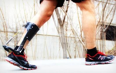 Thbe wearable exoskeleton that fits over a person's lower leg.