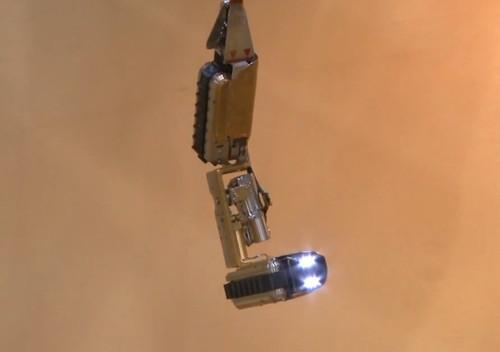A robot developed by the International Research Institute for Nuclear Decommissioning (IRID) and Hitachi-GE Nuclear Energy hangs from a pipe in a demonstration. On Friday, it began probing inside the primary containment vessel of the No. 1 reactor at Japan's crippled Fukushima Dai-ichi nuclear plant, which suffered meltdowns following the 2011 earthquake and tsunami.