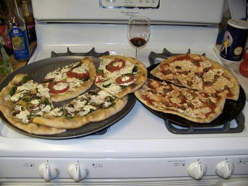 """Two pizzas sitting on top of a stove top oven,"" is how a Google program described this image."