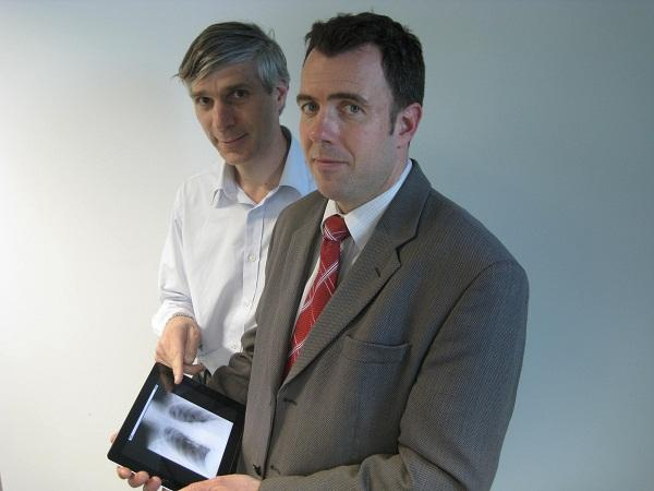 I-MED chief information officer, Bart Dekker, and I-MED Queensland general manager, Justin Mottram, view the iPad X-ray application.