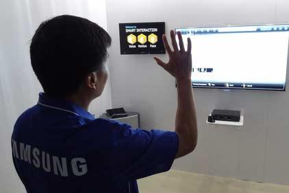 At the 2012 CES in Las Vegas, a Samsung demonstrator shows gesture controls on a set due out later this year.