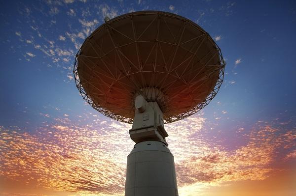 One of the Australian SKA Pathfinder radio telescope dishes at dusk in Western Australia.