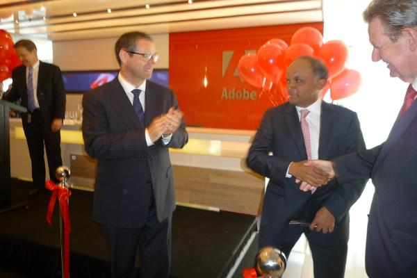 Communications minister Senator Stephen Conroy, Adobe CEO Shantanu Narayen and NSW Premier Barry O'Farrell cutting the ribbon to officially open the Adobe Australia office.