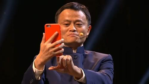 Alibaba Founder Jack Ma stares into the front camera of his phone to authorise a payment using Alipay