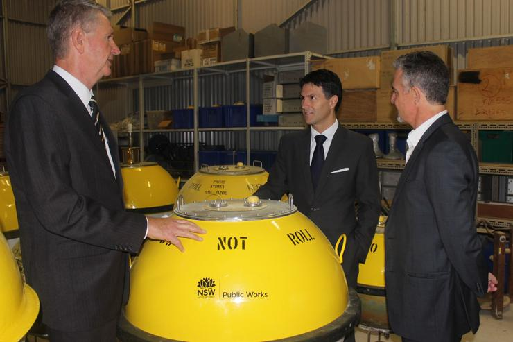 Brian Baker, Deputy Director-General, Office of Finance and Services (NSW Public Works), Victor Dominello, Minister for Innovation and Better Regulation, and Edward Couriel, Principal Engineer (Coastal Strategy) inspecting Waverider buoys at Manly Hydraulics Laboratory.