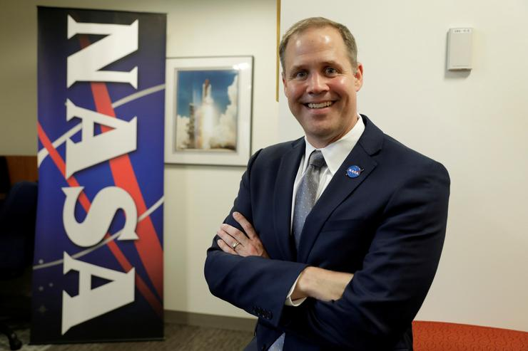 NASA Administrator Jim Bridenstine poses for a photographer after an interview with Reuters at NASA headquarters in Washington, U.S., August 21, 2018. REUTERS/Yuri Gripas/File Photo
