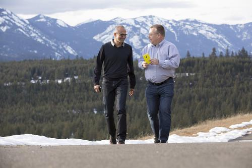Microsoft CEO Satya Nadella (left) and executive vice president of Microsoft Devices Group Stephen Elop share a moment as the deal that brings together Microsoft and the Nokia Devices and Services business closes today.