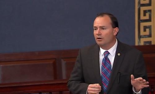 Senator Mike Lee, a Utah Republican, joins a filibuster on the Senate floor against extending the telephone records collection provision of the Patriot Act on May 20, 2015.
