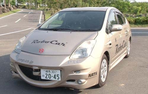 This image from a video supplied by Tokyo robotics company ZMP shows a prototype self-driving car at a test track in Japan.