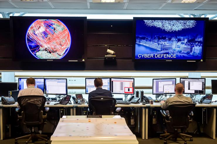 People sit at computers in the 24 hour Operations Room inside GCHQ, Cheltenham in Cheltenham, November 17, 2015. REUTERS/Ben Birchall/Pool/File Photo
