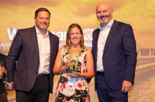 Rob Johnson, GM, Americas; Suzanne Naylor, Operations and Maintenance Value Stream Lead, Watercare Services Limited; and Cormac Watters, GM, International at the Infor 2019 Customer Excellence Awards presentation ceremony in New Orleans