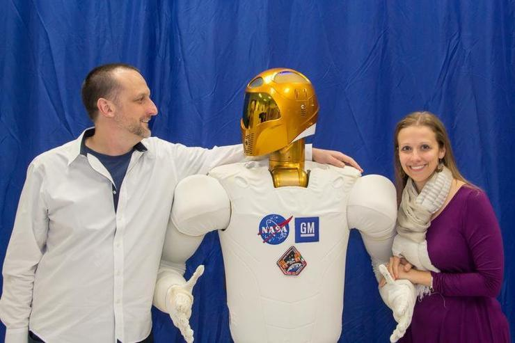 From left: Russell Potapinski, head of cognitive science and robotics, Woodside, middle is Robonaut and on the right is Julia Badger, Robonaut project manager, NASA.