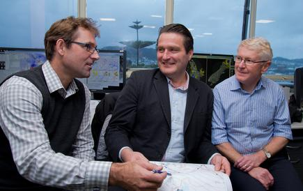 """Where MetService is different is we take other people's models, put our smarts both from our meteorologists and also from scientists, and bring these together,"" says Alistair Vickers (centre), with meteorologists Ramon Oosterkamp (left) and Peter Kreft (right)."