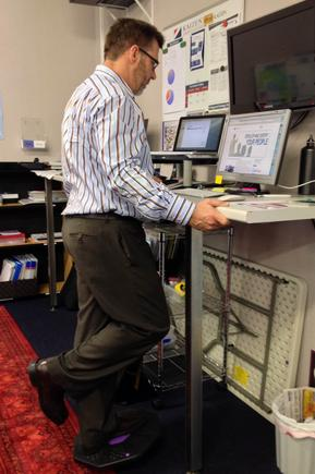 A balancing act: Danie Vermeulen, CEO of Kaizen Institute New Zealand, uses a balance board to reach the elevated workstations.