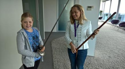 At a Microsoft Girls in Tech event, Angie Judge shows off her sword collection to Indigo Parker.