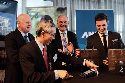 UnionPay International Chief Co-Operation Officer David Lee makes the first UnionPay Quickpass tap & go payment in New Zealand, while ANZ NZ CEO David Hisco (left) and the Minister of Economic Development, Hon Steven Joyce, look on.