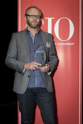Jeremy Nees receives the trophy for ICT-enabled community project category at the CIO100 awards.