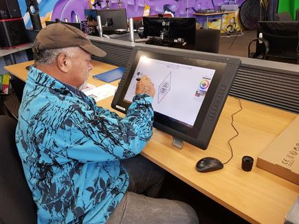 "Grant Strang of TWoA: ""One of our tauira (student) has been spending a lot of time over the past week using the design workstation. Mohe has been learning to use the Wacom screen to design a logo for his whānau. It hasn't taken him long to get the basics and grow confidence. He is fast becoming an expert."""