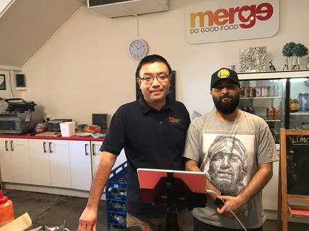 Neil Gong with Manu Kahlon, the Merge Café manager.