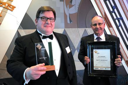 Matti Seikkula receiving his award from Mark Allan (NZIS) for Professional of the Year at the NZ Spatial Excellence Awards in Wellington.