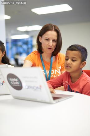 Orion Health Outreach coordinator Ruth James works with Adamya Manchanda at Code Club.