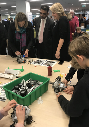 During the first Digital Day, Watercare chief digital officer Rebecca Chenery and chief executive Raveen Jaduram join the children in building robots